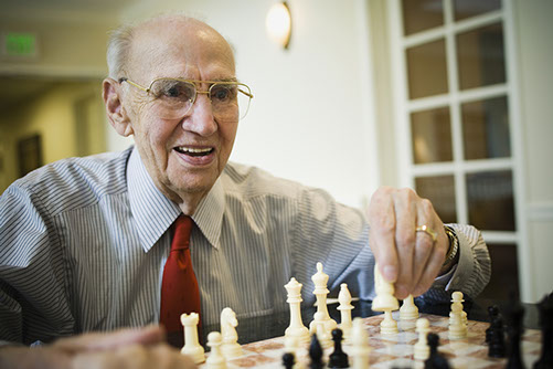 senior - man playing chess